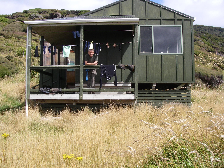 Burnsie on verandah of Long Harry Hut